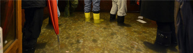water on the floor with people standing