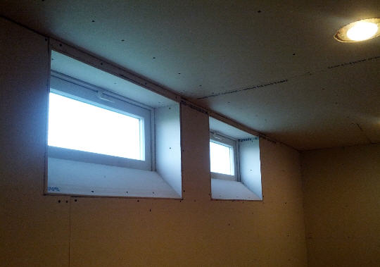 angled drywalled basement window idea